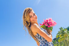 Outdoor portrait of young smiling beautiful woman enjoying sunny Stock Image