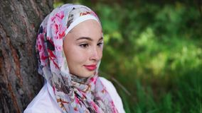 Outdoor portrait of young smiling Muslim woman stock video footage