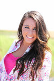 Outdoor portrait young smiling teen girl pink top Royalty Free Stock Photo