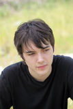 Outdoor portrait of young teen boy black shirt Royalty Free Stock Images