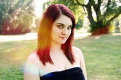 Outdoor portrait of a young woman royalty free stock photos