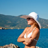 Outdoor portrait of young woman. In white hat Royalty Free Stock Photo
