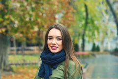 Outdoor portrait of young woman in autumnal city royalty free stock images