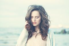 Outdoor Portrait of Young Woman Looking Royalty Free Stock Photography