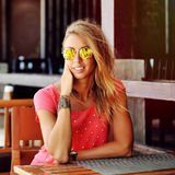 Outdoor portrait of young woman in sunglasses - close up Stock Photography