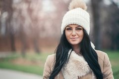 Portrait of a young woman wearing a coat and hat Royalty Free Stock Photos