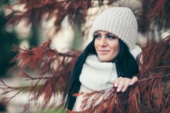 Portrait of a young woman wearing a coat and hat Royalty Free Stock Photography