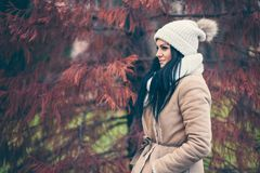 Portrait of a young woman wearing a coat and hat Royalty Free Stock Image