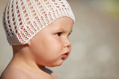 Outdoor profile portrait of curious Caucasian baby Stock Image