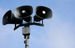 Outdoor Public-address speakers. Outdoor public address loudspeakers with sky background Royalty Free Stock Photography