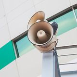 Outdoor public loudspeakers. Outdoor white public loudspeakers background stock photography