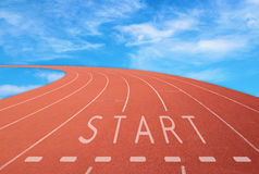 Outdoor racetrack with sign start with blue sky background Stock Images