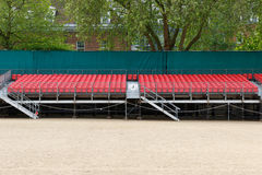 Outdoor Raked Seating. Temporary outdoor raked red spectator seating Stock Photography