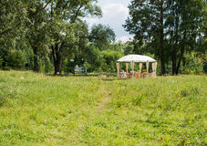 Outdoor reception under tent and trees. Royalty Free Stock Image