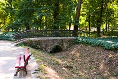 Outdoor recreation outdoor park with benches and bridge in spring royalty free stock photo