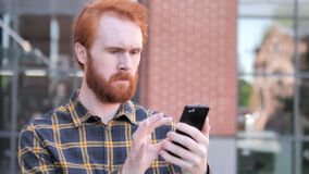 Outdoor Redhead Beard Young Man Using Smartphone. 4k high quality, 4k high quality stock video footage