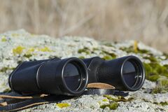 Free Outdoor Research Equipment. Birdwatching And Bird Protection. The Binoculars Lie On The Stone Stock Image - 214024001