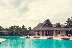 Outdoor resort pool Swimming pool of luxury hotel. Swimming pool in luxury resort near the sea. Tropical Paradise. Swimming pool i Royalty Free Stock Images
