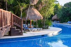 Outdoor resort swimming pool area. Riviera Maya, Cancun, Mexico stock photos