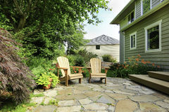 Outdoor rest area. Backyard with wooden chairs Royalty Free Stock Photo