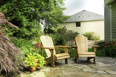 Outdoor rest area. Backyard with wooden chairs Royalty Free Stock Photography