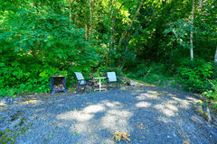 Outdoor rest area with chair and table Royalty Free Stock Images