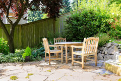 Outdoor rest area with rustic table and chairs Royalty Free Stock Image