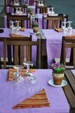 Outdoor restaurant. Violet and orange table setting in outdoor restaurant Royalty Free Stock Photos