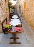 Outdoor restaurant. On a narrow pedestrian street in Hvar, Croatia Stock Photo