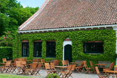 Outdoor restaurant. Peaceful romantic outdoor restaurant by old building Stock Photo