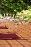Outdoor restaurant. The focu is on the first glasses Stock Image