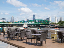 Outdoor restaurant and background is bridge. Royalty Free Stock Images