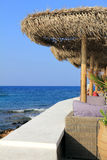 Outdoor restaurant at the beach. A wonderful outdoor restaurant at the beach, with .view on open sea, Crete Stock Images
