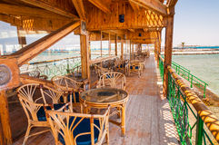 Outdoor restaurant with beautiful sea view Royalty Free Stock Photos