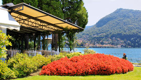 An outdoor restaurant with beautiful view on Lake Como, Italy Stock Photo