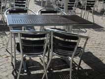 Outdoor restaurant  cafe chairs with table Royalty Free Stock Images
