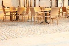 Outdoor restaurant chair. Outdoor restaurant - beige outdoor dining Stock Images