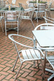 Outdoor restaurant coffee open air cafe chairs with table. Royalty Free Stock Photography