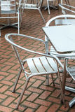 Outdoor restaurant coffee open air cafe chairs with table. Royalty Free Stock Images