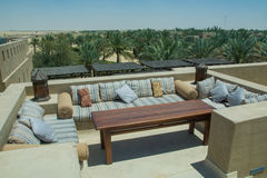 Outdoor restaurant lounge on the roof top with sofas table and comfortable pillows at the desert luxury resort Stock Photo