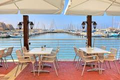 Outdoor restaurant on Mediterranean sea. Stock Photo