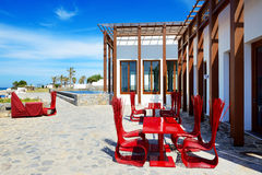The outdoor restaurant near beach at luxury hotel Stock Image
