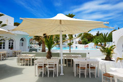 The outdoor restaurant near swimming pool at luxury hotel Stock Photography