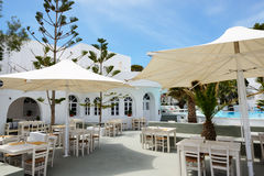 The outdoor restaurant near swimming pool at luxury hotel Royalty Free Stock Photography