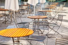 Outdoor restaurant open air cafe chairs with table Stock Image