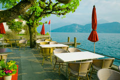 Outdoor restaurant over lake and mountains in the background Royalty Free Stock Photography
