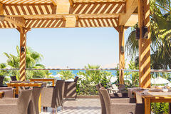 Outdoor  restaurant overlooking the sea and palm trees Royalty Free Stock Photo