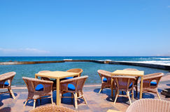 Outdoor restaurant at the seafront Stock Images