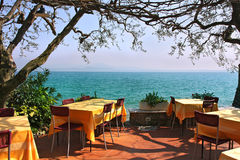 Outdoor restaurant in Sirmione, Italy. Royalty Free Stock Photo