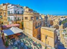 Outdoor restaurant on St Peter and Paul Bastion, Valletta, Malta. VALLETTA, MALTA - JUNE 17, 2018: The large outdoor terrace of the restaurant, located on St Royalty Free Stock Photography